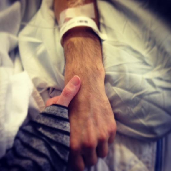 Holding hands while Derek naps.