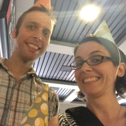 Waiting for the birthday girl at the airport! People were pretty jealous of our party hats.