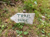 The trail head is tucked in between two houses.
