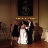 The bride and groom give a speech.