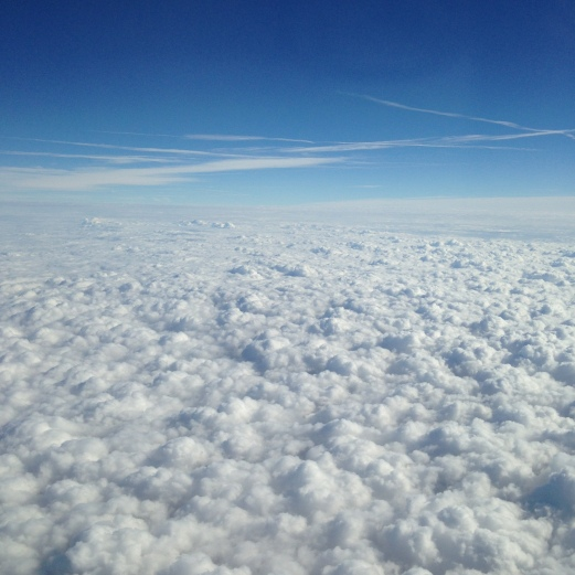 Puffy clouds from the plane.
