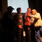 Michael Wells presents Derek with his namesake award.