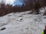 Coming down the trail, the last of the snow.