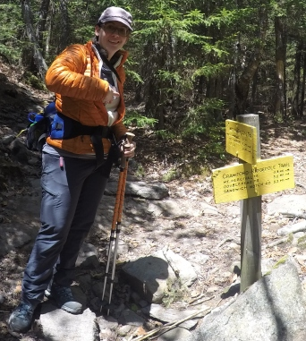 Hiking down, stopping at signs.