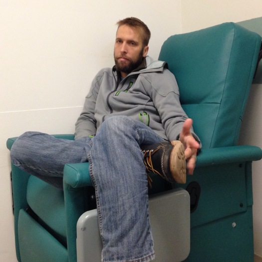 Derek in pre-op, sitting in what he calls the most uncomfortable chair ever.